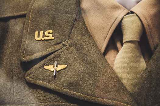 gold colored us brooch on apparel